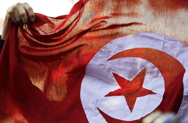 A person holds up a Tunisian flag and shouts slogans during celebrations marking the fourth anniversary of Tunisia's 2011 revolution, in Habib Bourguiba Avenue in Tunis January 14, 2015. REUTERS/Anis Mili (TUNISIA - Tags: POLITICS ANNIVERSARY CIVIL UNREST) - RTR4LGEG